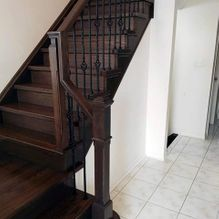 dark wood staircase and railing